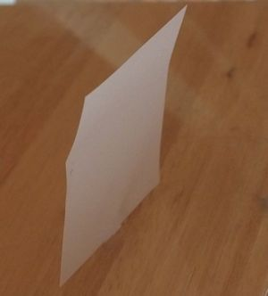 Paper standing on edge
